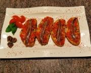 Bruschetta, köstlich würzig mit Tomaten und Sardellenfilets